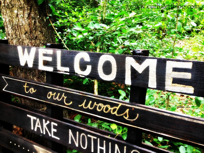 Welcome to our woods sign