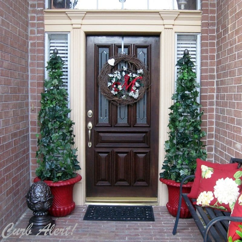 Front door decorated with tomato cage topiaries