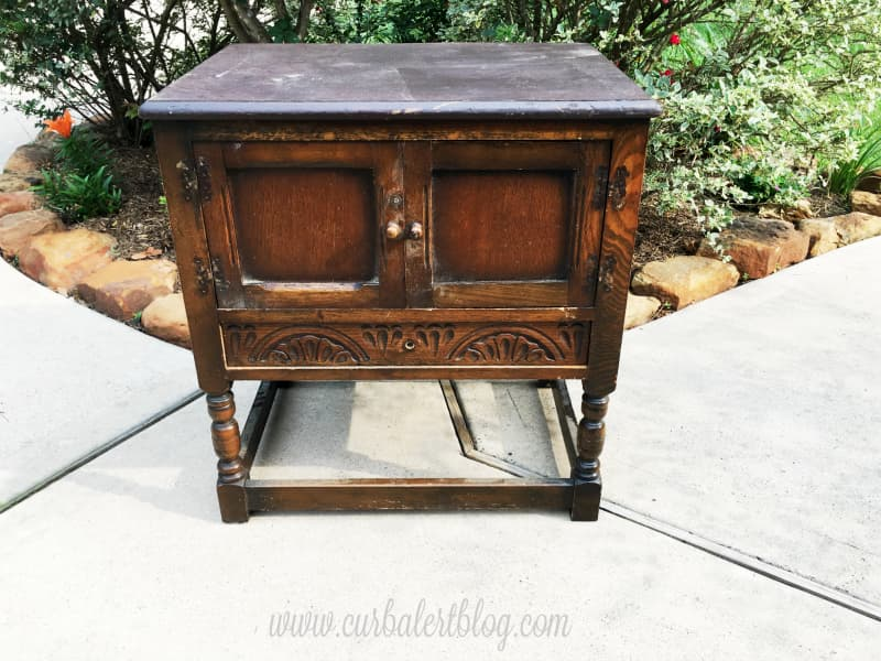 My future farmhouse end table find at the curb