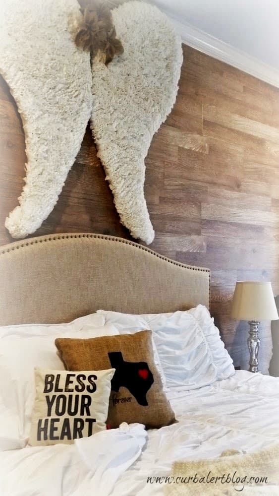 The angel wings displayed above our bed