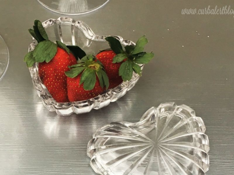 Dish of strawberries on the silver dresser