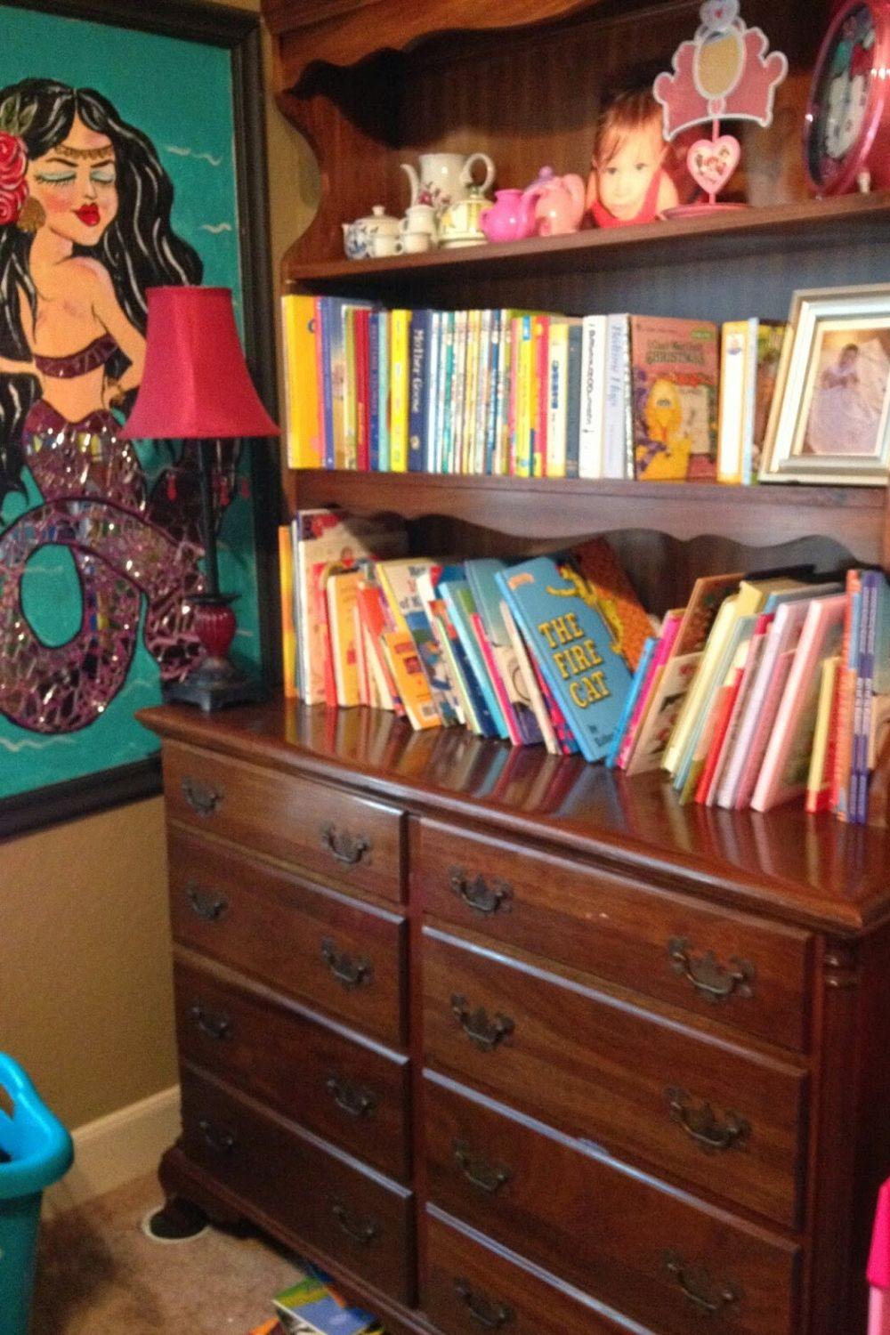 Old dresser and hutch filled with books